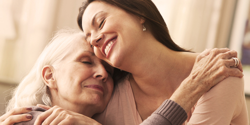 Young woman hugging an elderly woman - dealing with your loved one's declining health