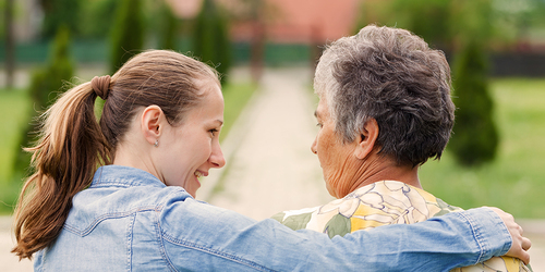 Older woman sitting outside with younger woman - plan for your caregiving