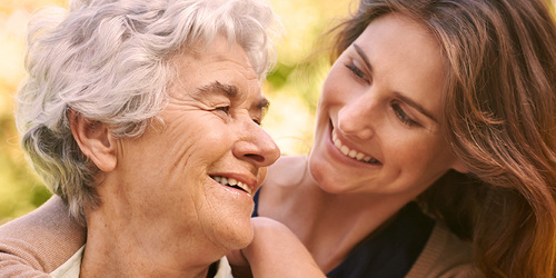 Young woman hugging and older woman - understanding the type of incontinence your loved one has