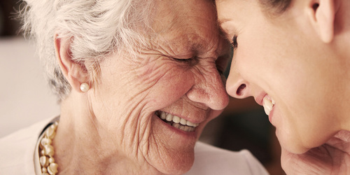 Elderly lady and younger woman laughing – read Petra's story