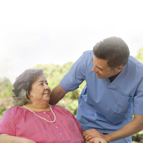 Image of a patient and a caregiver - TENA Professional