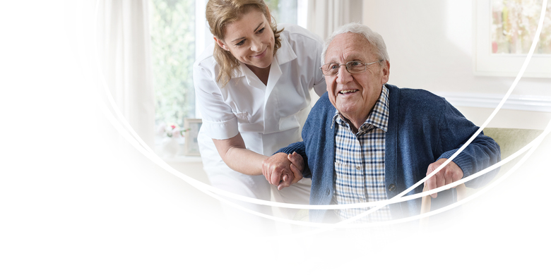 Image of Nurse and Resident - Quality of Care - TENA Professional