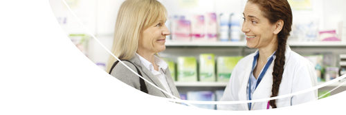 Pharmacist helping customer in front of computor