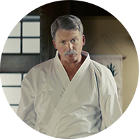 Stirling Gravitas wearing a japanese gi for martial arts.