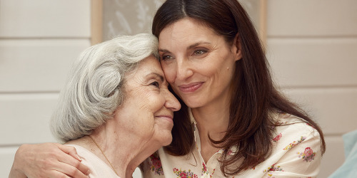 Younger woman hugging older woman