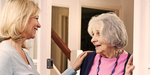 Younger woman greeting an older woman – starting your caregiving journey