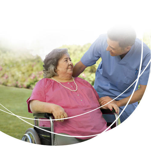 Image of Woman Resident and Caregiver - Bariatric - TENA Professional