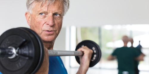 TENA Men lifting weights