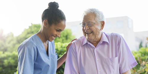 Image of Resident meeting with Nurse and Smiling- TENA Professional