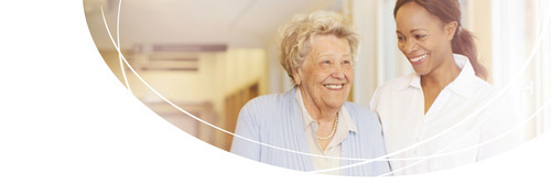 Image of Elderly Woman Speaking with a Nurse - TENA Professional
