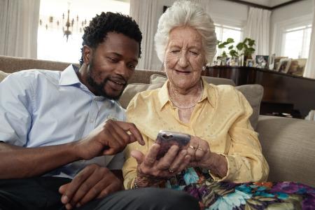 TENA-Lifestyle-old-woman-with-male-nurse.jpg